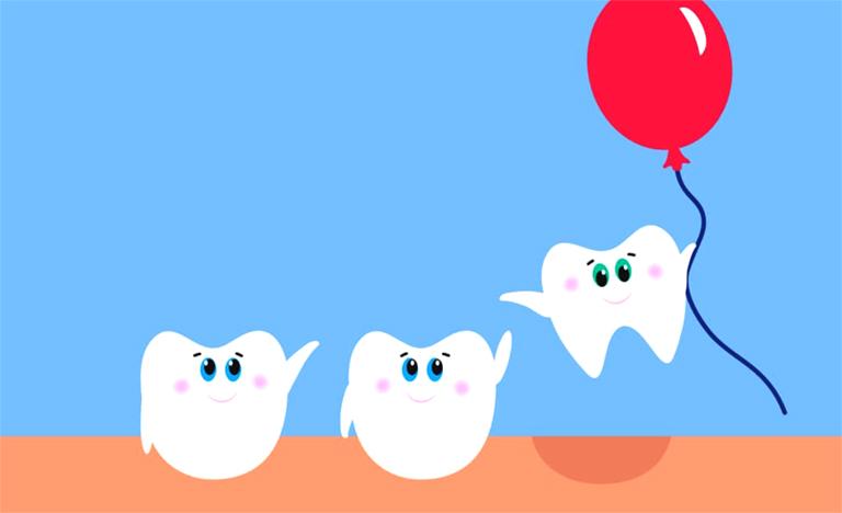 răng khôn mọc lệch nhưng không đau có nên nhổ